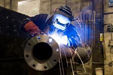 Welding in our Machine Shop Facility - Exline, Inc.